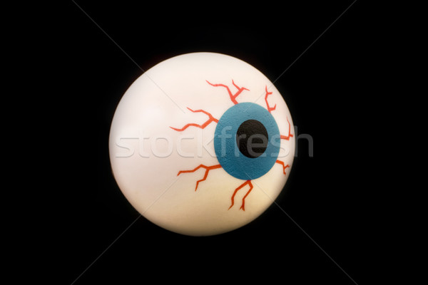 Rubber toy eyeball isolated over black Stock photo © lucielang