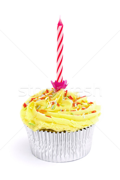 Stock photo: Yellow cupcake with sprinkles and a candle over white