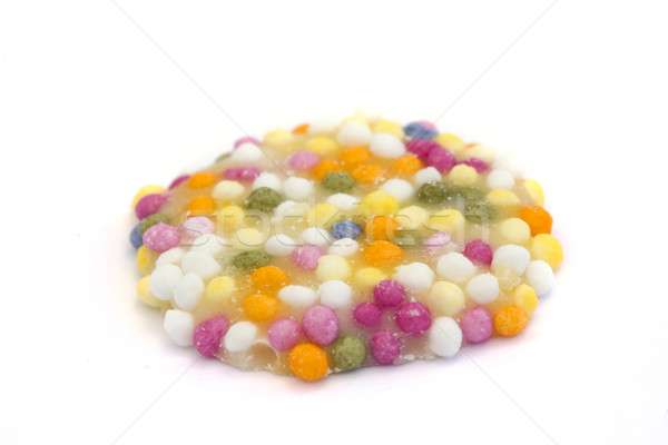Stock photo: white chocolate button with sprinkles