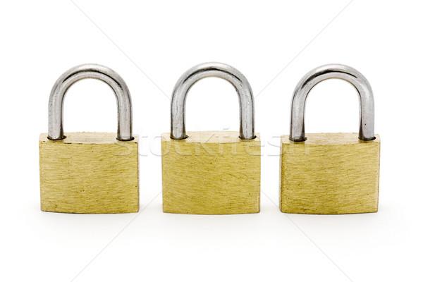 Three padlocks in a row Stock photo © lucielang