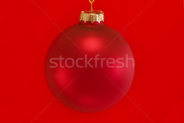 Single red bauble isolated over red Stock photo © lucielang