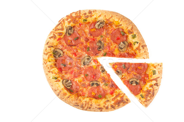 Whole pizza top view with a slice cut Stock photo © lucielang