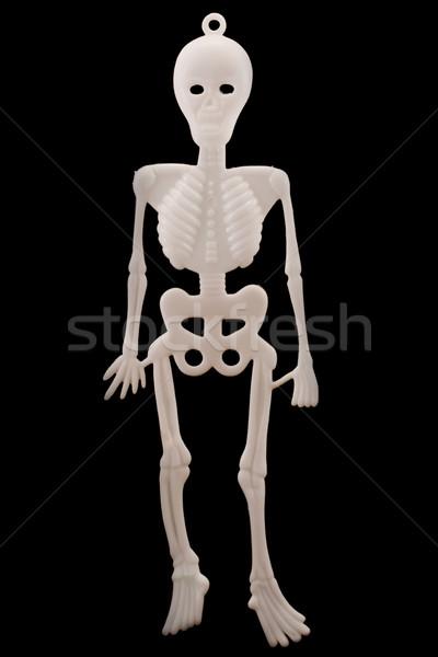 White plastic skeleton over black Stock photo © lucielang