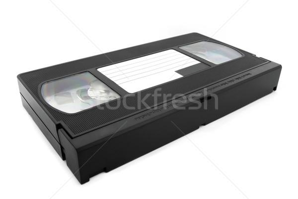 Black VHS tape over white Stock photo © lucielang