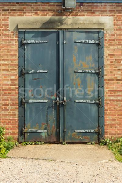 Old rusty padlocked blue metal door Stock photo © lucielang