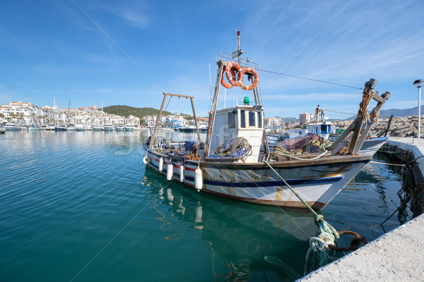 Fishing Boat in a harbour. Stock photo © lucielang