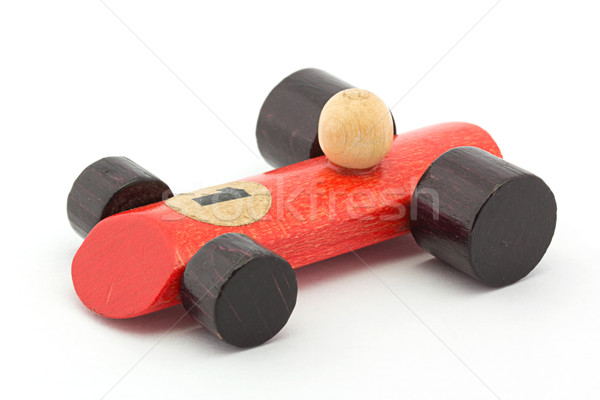 Small red wooden toy racing car on white Stock photo © lucielang