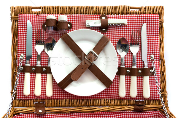 Old fashioned wicker picnic basket with cutlery Stock photo © lucielang