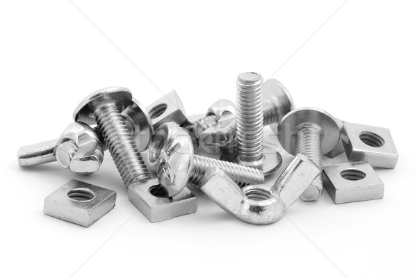 Pile of nuts and bolts over white Stock photo © lucielang