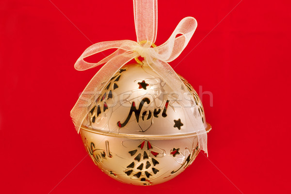 Gold bauble isolated on red Stock photo © lucielang