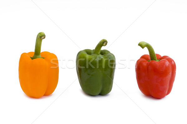 Red yellow and green peppers on white. Stock photo © lucielang