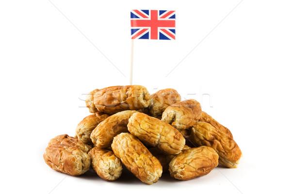 Köteg kolbászok brit zászló fehér buli zászló Stock fotó © lucielang