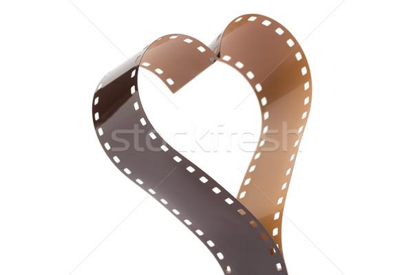 Forme de coeur 35mm négatifs bande de film caméra blanche Photo stock © lucielang