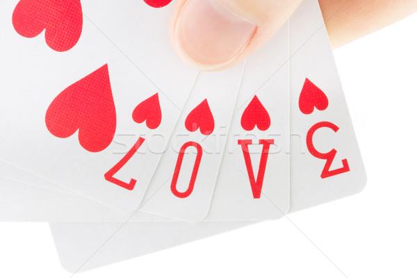 Mão cartas de jogar ortografia palavra amor Foto stock © lucielang