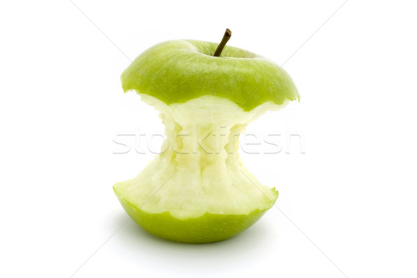 Green apple core over white Stock photo © lucielang