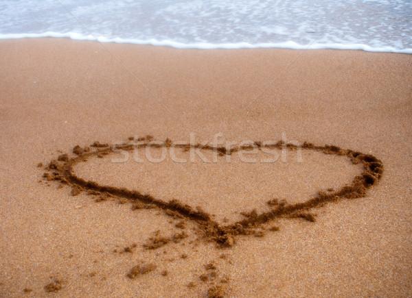 Kalp imzalamak kum su sanat uzay Stok fotoğraf © luckyraccoon
