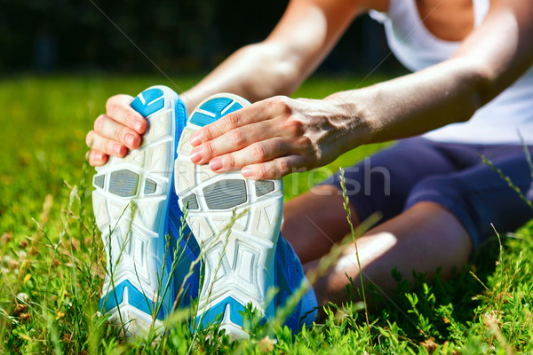 Young woman stretching before exersise - closeup shot. Stock photo © luckyraccoon