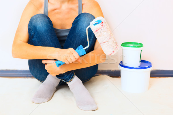 Closeup of woman sitting with paint and brush ready to work Stock photo © luckyraccoon