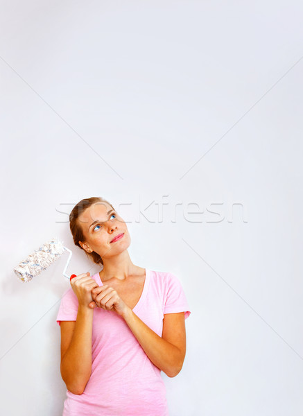 Happy woman with roller brush dreaming  Stock photo © luckyraccoon