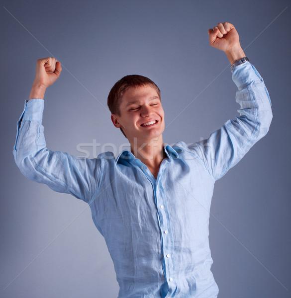 Jonge gelukkig man opgeheven handen portret business Stockfoto © luckyraccoon