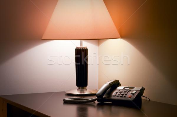 Tavola lampada telefono luce hotel studio Foto d'archivio © luckyraccoon