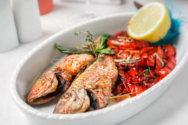 Fried fish with red peppers and lemon. Stock photo © luckyraccoon