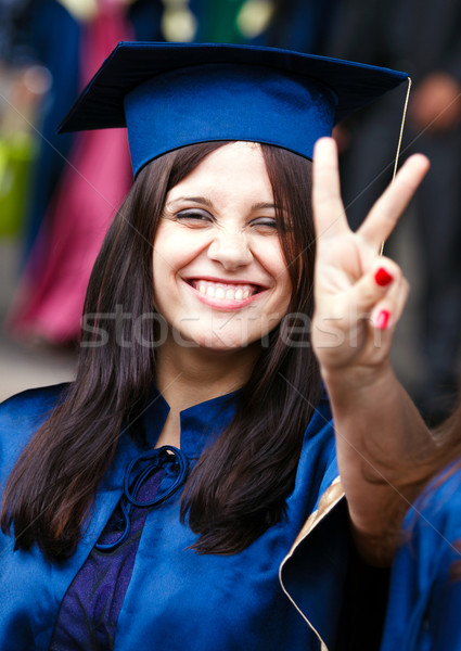 Image of a happy young graduate Stock photo © luckyraccoon
