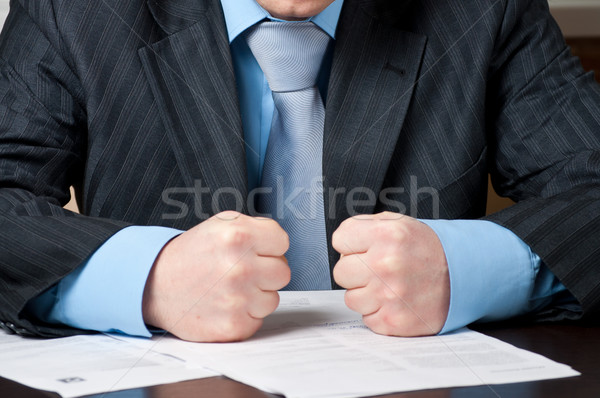 closeup of  businessman with clenched fists Stock photo © luckyraccoon