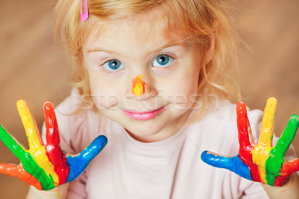 Cute little girl with painted hands. Stock photo © luckyraccoon
