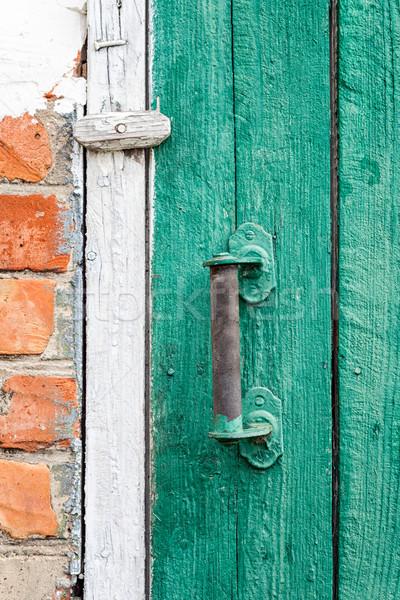 Vecchio intemperie porta legno architettura Foto d'archivio © luckyraccoon