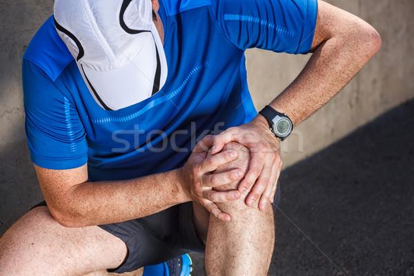Férfi futó problémák térd ízület út Stock fotó © luckyraccoon