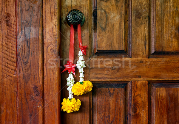 Traditional Thai bouquet hanging on wooden door Stock photo © luckyraccoon