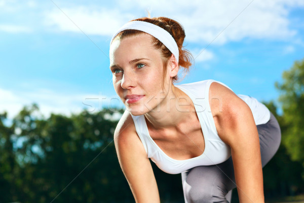 Retrato bela mulher pronto começar corrida corpo Foto stock © luckyraccoon