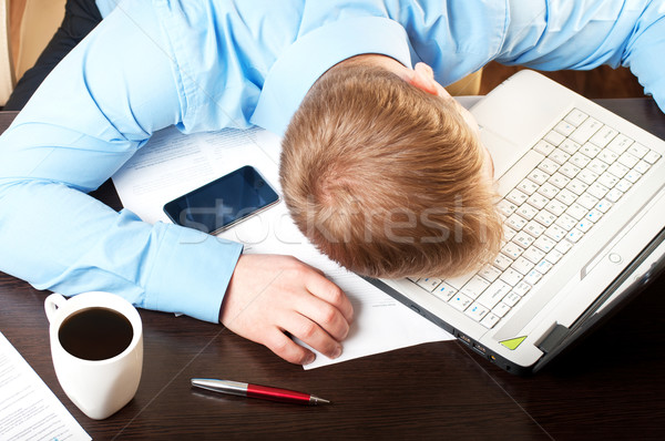 Young businessman sleeping on his table  Stock photo © luckyraccoon