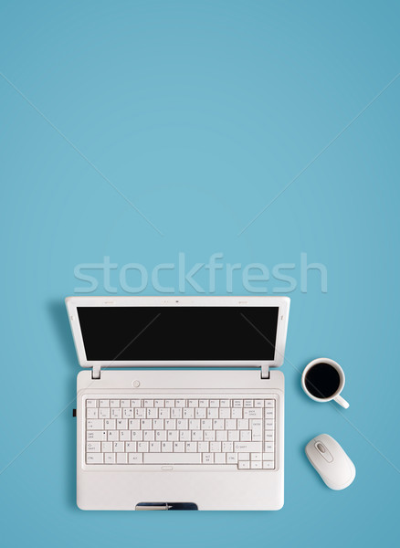 White laptop on table - place for text. Stock photo © luckyraccoon