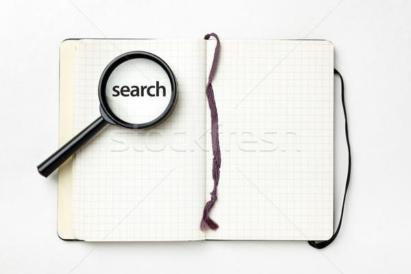 Abierto cuaderno lupa blanco búsqueda negocios Foto stock © luckyraccoon