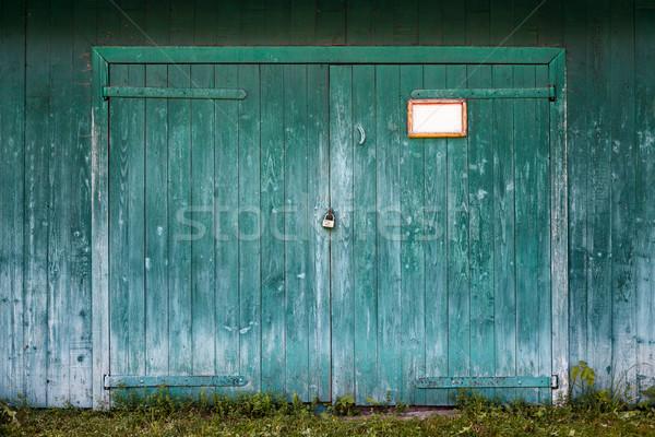Old wooden barn door. Stock photo © luckyraccoon