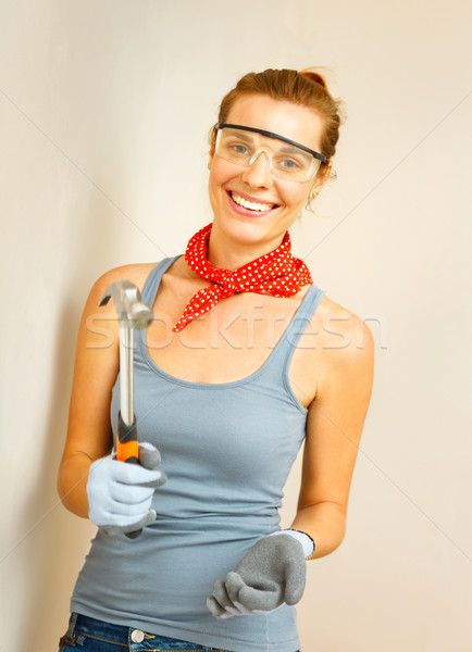 Young woman with hammer in hands. Stock photo © luckyraccoon
