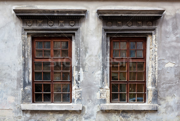 Two windows on an old gray stucco wall. Stock photo © luckyraccoon