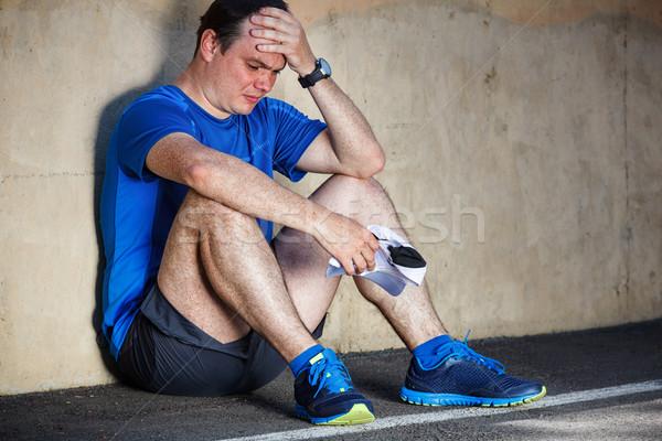 üzgün genç erkek koşucu Stok fotoğraf © luckyraccoon