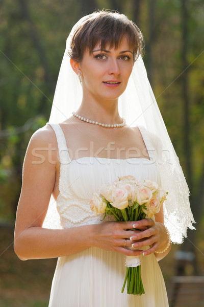 Beautiful Bride with wedding bouquet  Stock photo © luckyraccoon