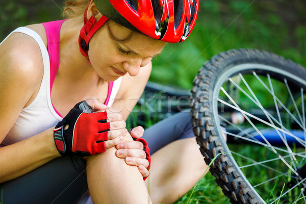 Young woman fell off mountain bike. Stock photo © luckyraccoon
