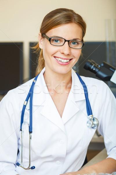 Retrato jovem médico laboratório olhando câmera Foto stock © luckyraccoon