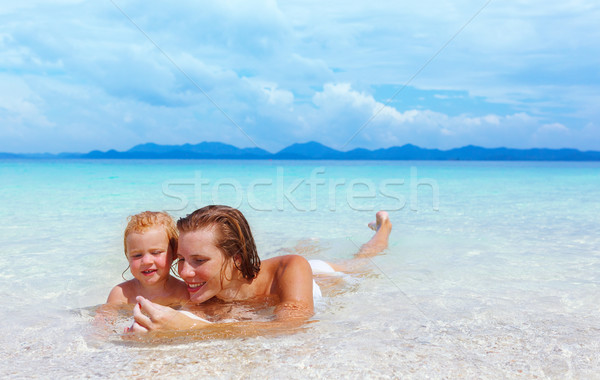 Mother with baby girl on summer beach Stock photo © luckyraccoon