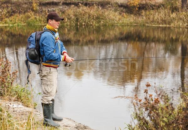 Pescador otono pesca temporada hombre deporte Foto stock © luckyraccoon