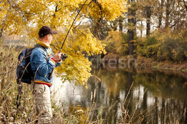 Fisherman with spinning. Stock photo © luckyraccoon