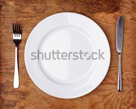 Cuchillo tenedor placa mesa de madera superior vista Foto stock © luckyraccoon