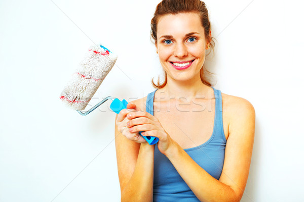 Feliz mujer cepillo pie pared trabajo Foto stock © luckyraccoon