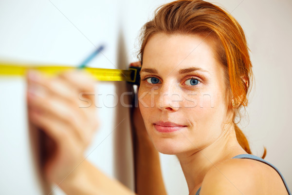 Portrait of young woman with measuring tape. Stock photo © luckyraccoon
