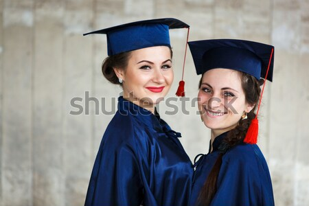 Kép boldog fiatal diplomás szabadtér lövés Stock fotó © luckyraccoon